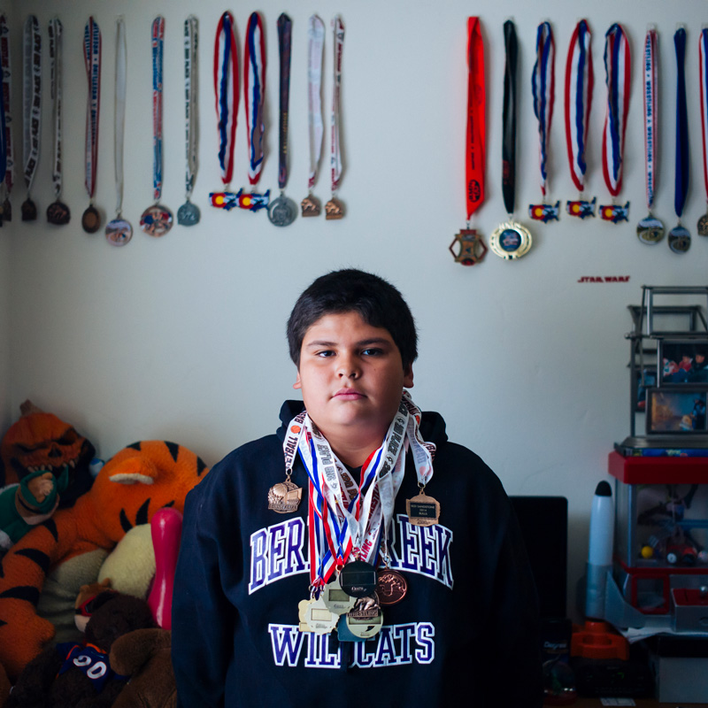 kid with a lot of medals